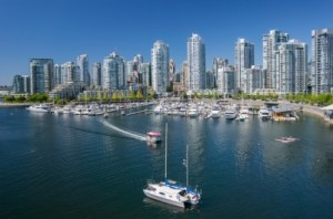 A view over downtown Vancouver from the harbour on a sunny day