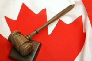 A gavel rests on a Canadian flag