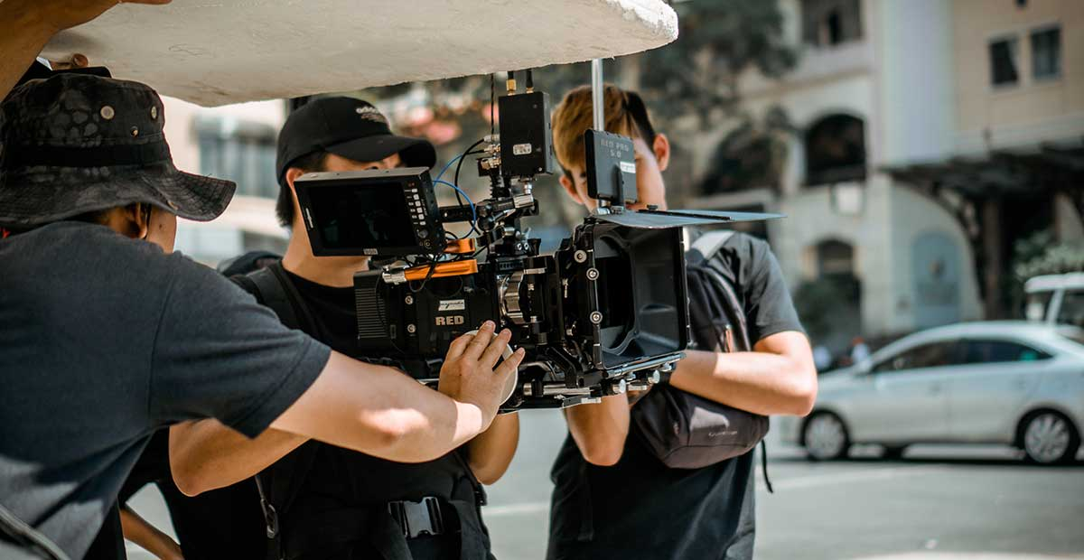 Cameraman camera operator holding camera film industry