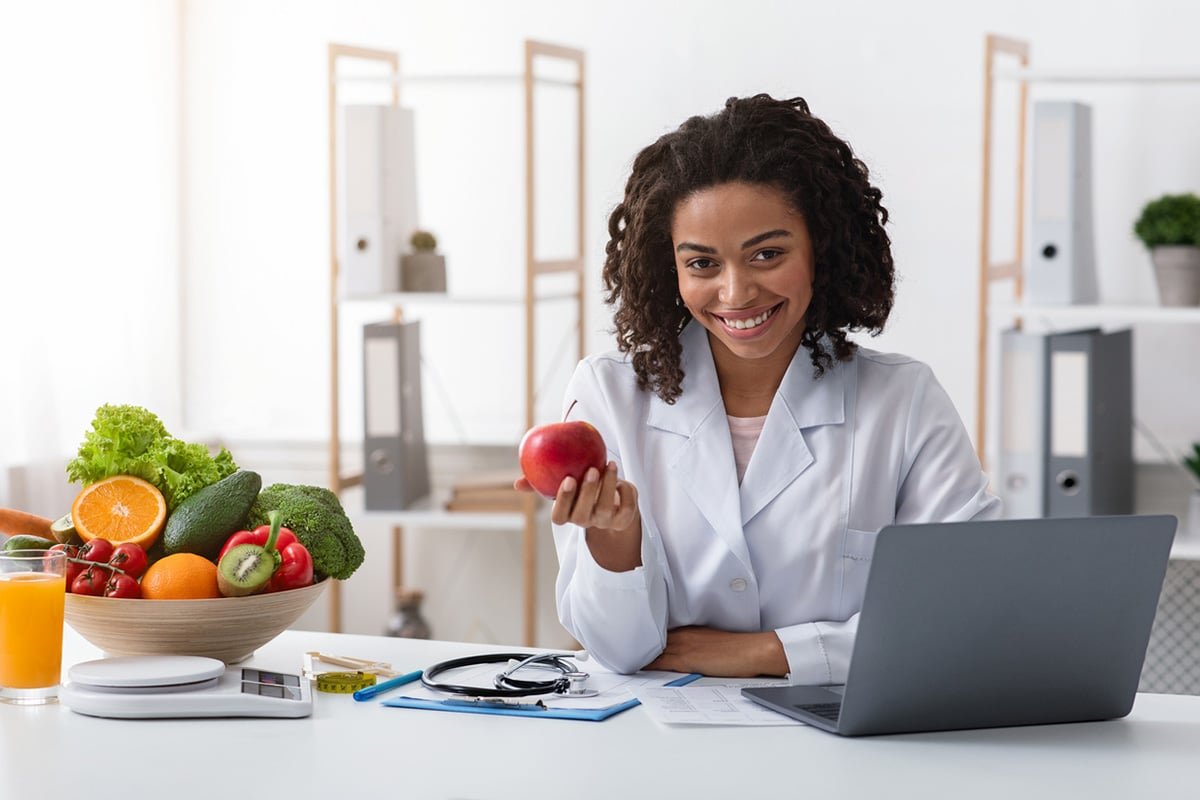 Nutritionist holding an apple