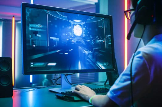 Person playing video games in high tech room.