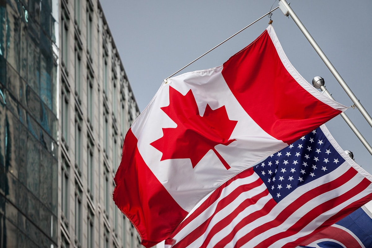 Canada flag in front of U.S. flag