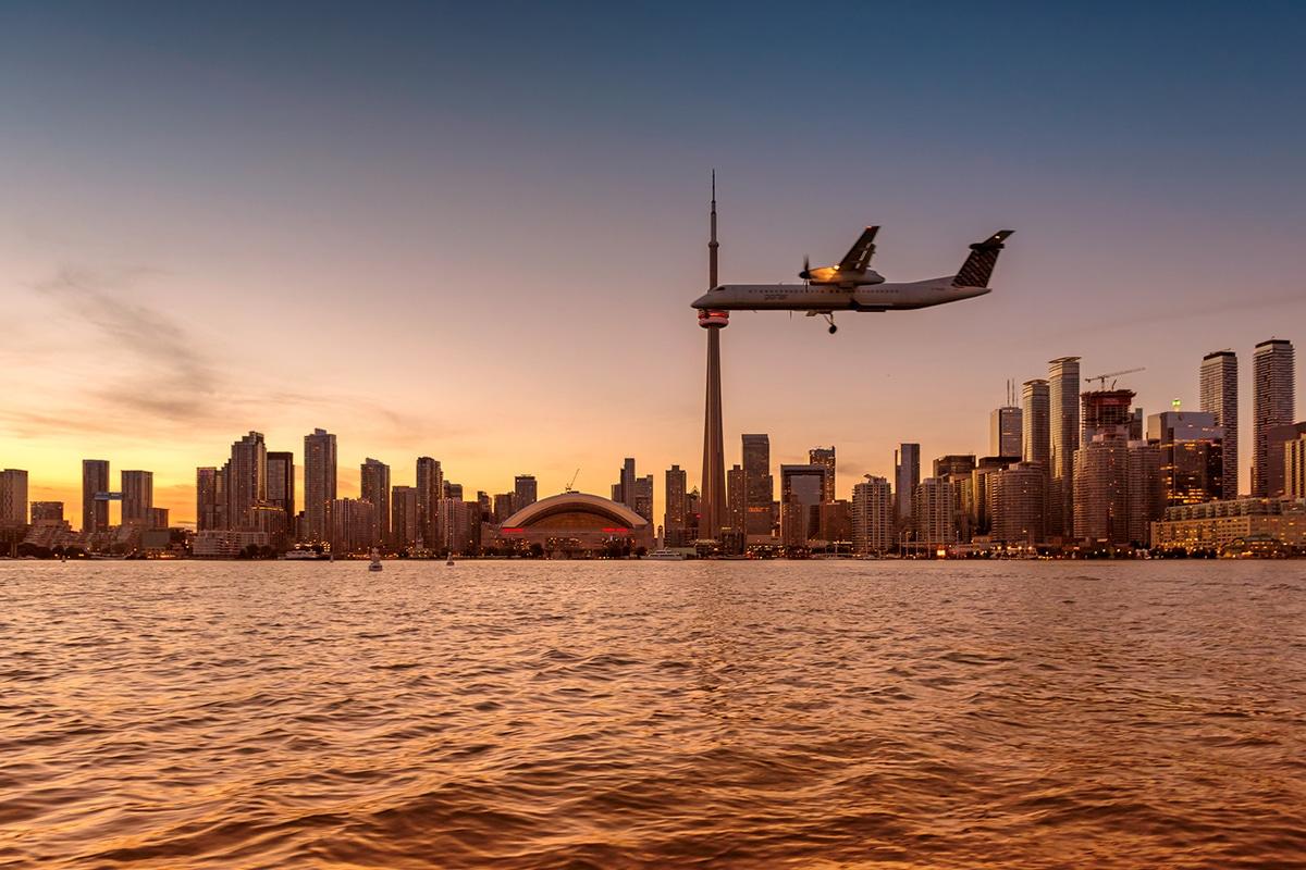 Airplane flying over Toronto