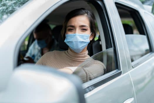 Driver wearing surgical mask