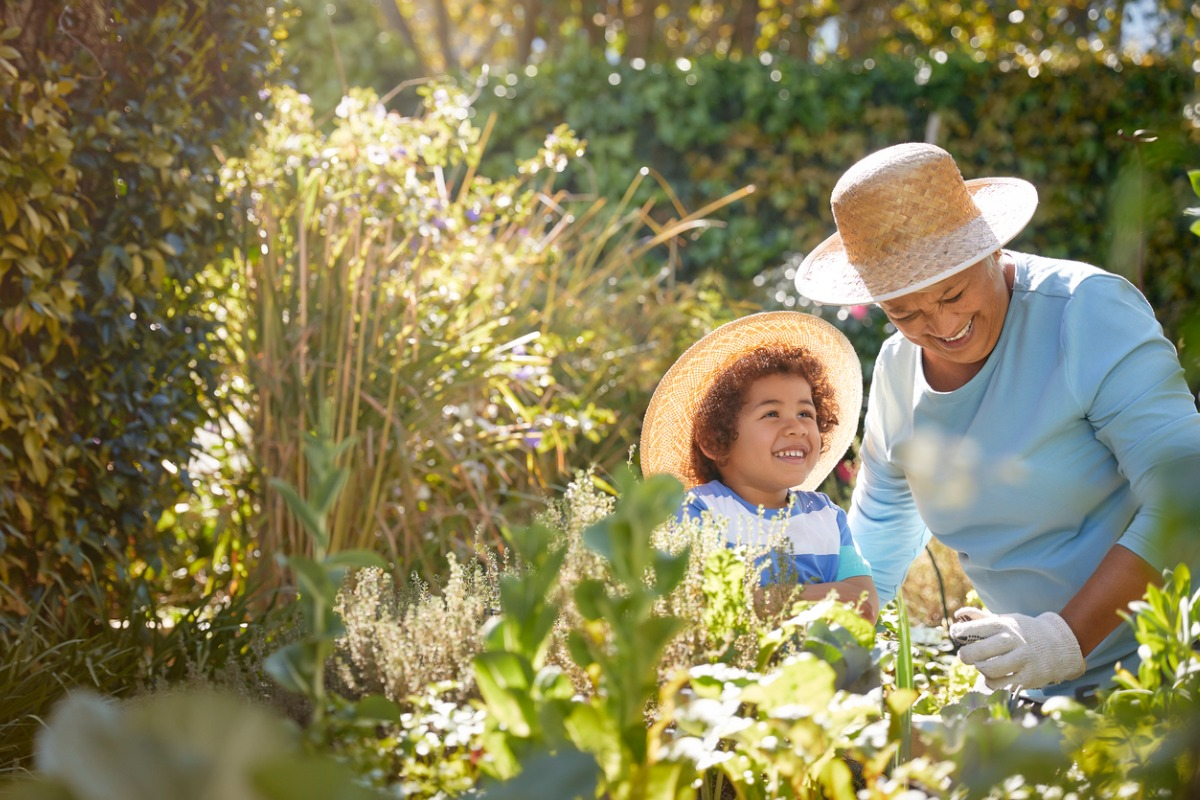 Grandchild and grandmother in a garden